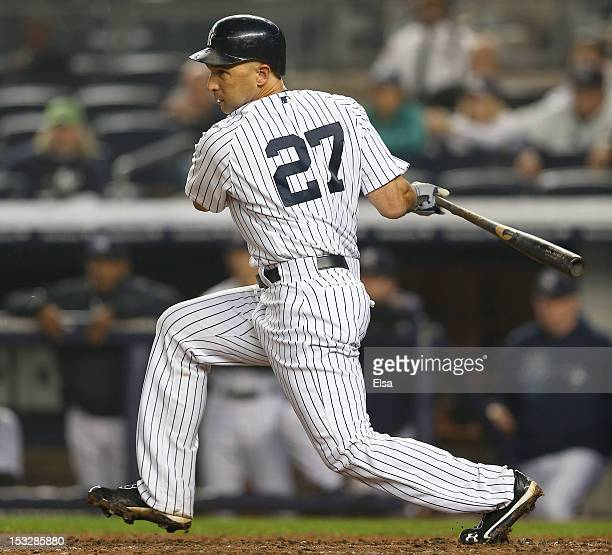 Raul Ibanez of the New York Yankees hits an RBI in the bottom of the 12th inning against the Boston Red Sox to win the game on October 2 2012 at...