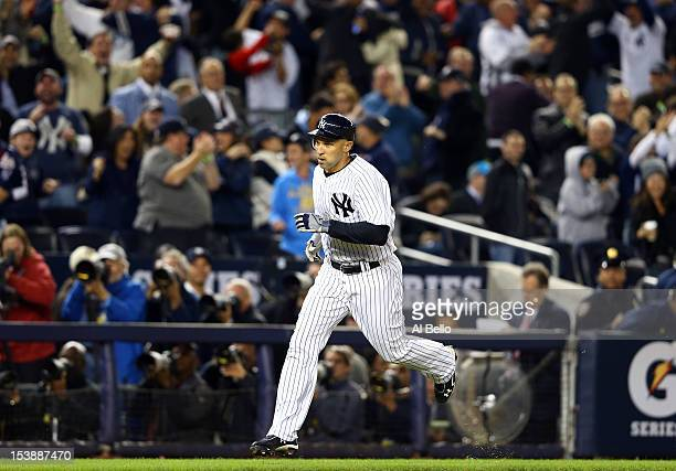Raul Ibanez of the New York Yankees rounds the bases after hitting a solo home run in the bottom of the ninth inning to tie Game Three of the...