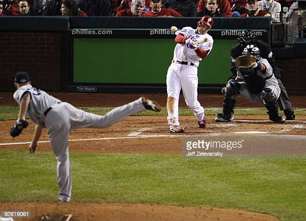 Raul Ibanez of the Philadelphia Phillies hits a RBI single in the third inning off AJ Burnett of the New York Yankees in Game Five of the 2009 MLB...