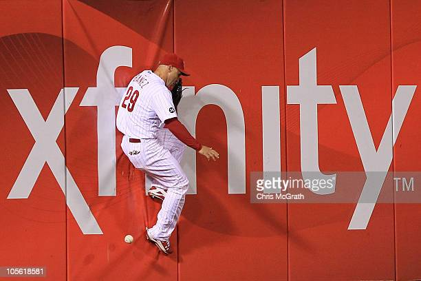 Raul Ibanez of the Philadelphia Phillies is unable to make a catch of a ball hit by Pat Burrell of the San Francisco Giants in the sixth inning to...