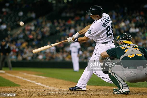 Raul Ibanez of the Seattle Mariners hits a threerun homer in the seventh inning against the Oakland Athletics at Safeco Field on June 22 2013 in...