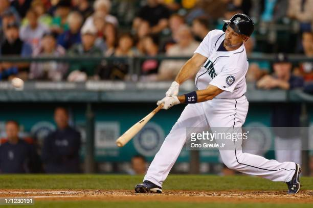 Raul Ibanez of the Seattle Mariners hits his second home run of the game against the Oakland Athletics in the fourth inning at Safeco Field on June...