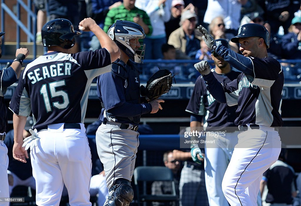 Raul Ibanez #28 of the Seattle Mariners is congratulated at home plate by teammate Kyle Seager #15 after hitting a three run home run against the San Diego Padres in the first inning during the spring training game at Peoria Sports Complex on February 24, 2013 in Peoria, Arizona.