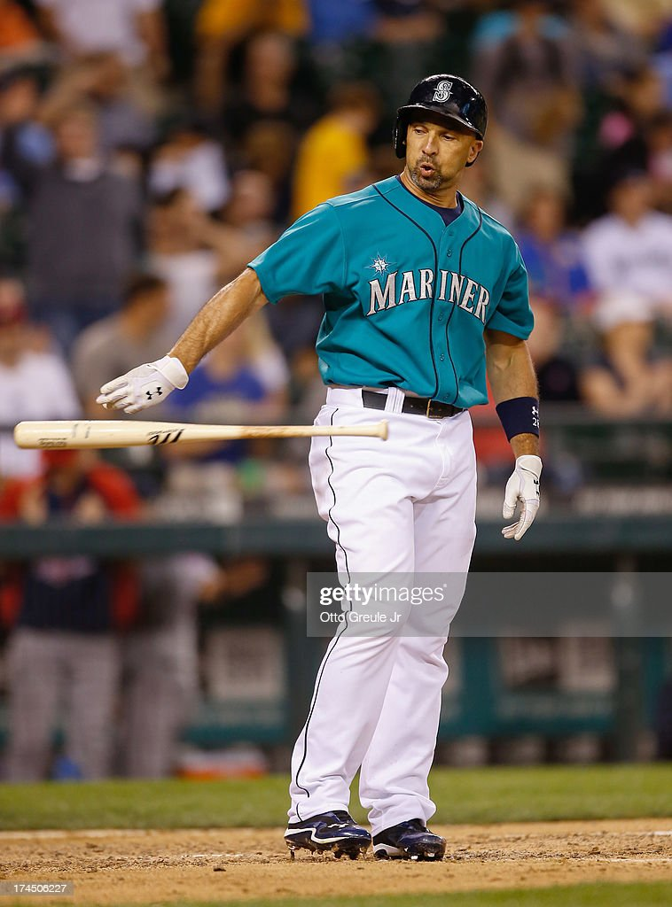 Raul Ibanez #28 of the Seattle Mariners tosses his bat away after striking out with two runners on base to end the twelfth inning against the Minnesota Twins at Safeco Field on July 26, 2013 in Seattle, Washington.