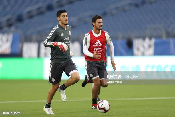 Raul Jimenez and Oswaldo Alanis of Mexico warms up during the traning session prior to the international friendly game between Mexico and United...