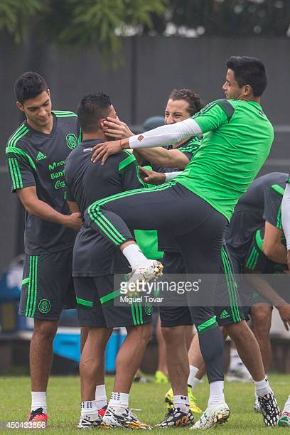 Raul Jimenez Andres Guardado and Alfredo Talavera of Mexico's National Soccer Team joke with Marco FAbian during a training session at O' Rei Pele...
