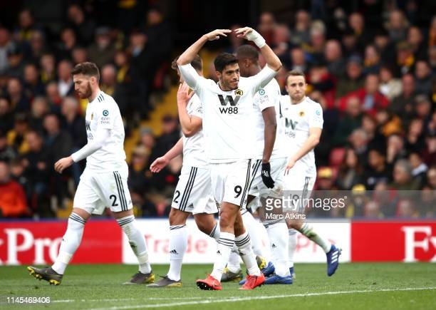 Raul Jimenez celebrates as Diogo Jota of Wolverhampton Wanderers scores his team's second goal during the Premier League match between Watford FC and...