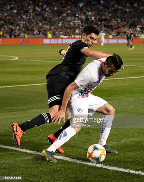 Raul Jimenez left of Mexico fights for the ball with Arturo Vidal of Chile during the International Friendly match between Mexico and Chile at SDCCU...