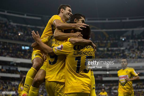 Raul Jimenez of America celebrates with teammates after scoring his third goal and fourth of his team during the Quarterfinal first leg match between...
