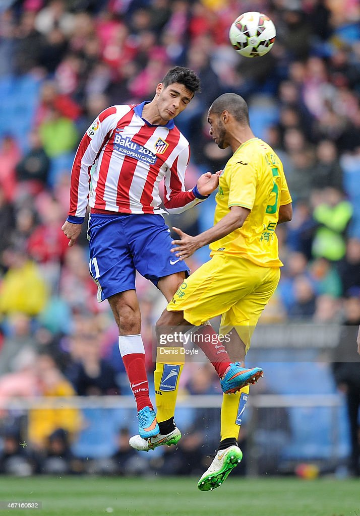 Raul Jimenez of Club Atletico de Madrid goes for a high ball against Naldo of Getafe CF during the La Liga match between Club Atletico de Madrid and Getafe CF at Vicente Calderon Stadium on March 21, 2015 in Madrid, Spain.