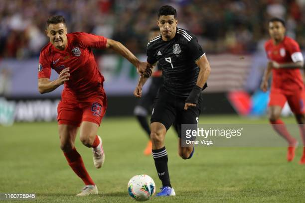 Raul Jimenez of Mexico and Aaron Long of United States fight the ball during the CONCACAF Gold Cup 2019 final match between United States and Mexico...