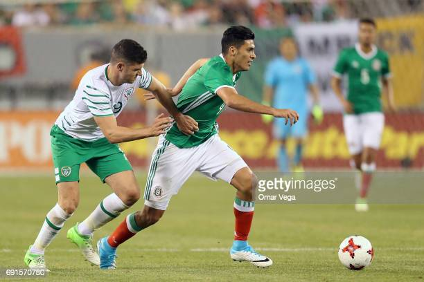 Raul Jimenez of Mexico and Daryl Murphy of Irland during the friendly match between the Republic of Ireland and Mexico at MetLife Stadium on June 01...