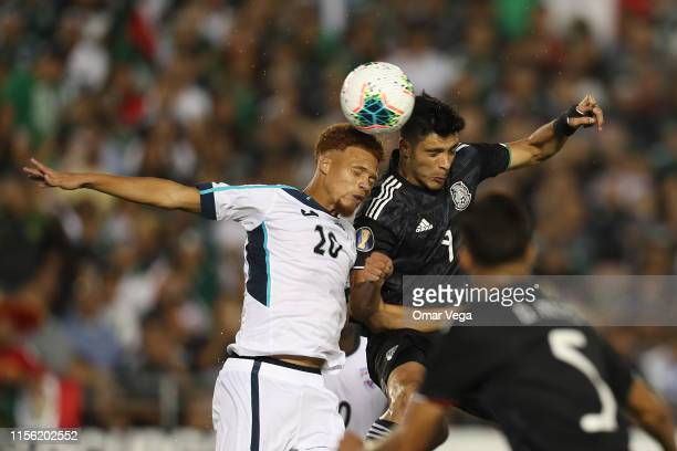 Raul Jimenez of Mexico and Luismel Morris of Cuba head the ball during a CONCACAF Gold Cup Group A match between Mexico and Cuba at Rose Bowl on June...