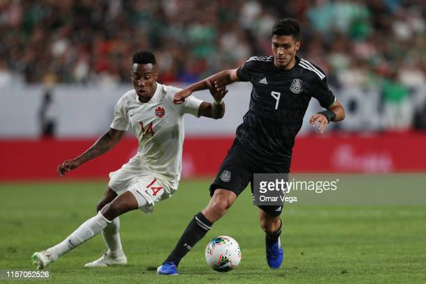 Raul Jimenez of Mexico and Markanthony Kaye of Canada fight the ball during the Group A match between Mexico and Canada as part of the 2019 CONCACAF...