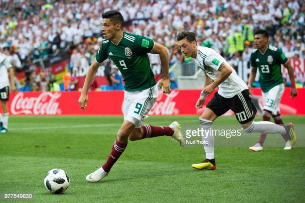 Raul Jimenez of Mexico and Mesut Oezil of Germany during the 2018 FIFA World Cup Russia Group F match between Germany and Mexico at Luzhniki Stadium...