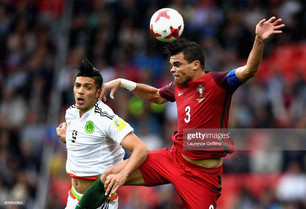 Raul Jimenez of Mexico and Pepe of Portugal battle to win a header during the FIFA Confederations Cup Russia 2017 Play-Off for Third Place between Portugal and Mexico at Spartak Stadium on July 2, 2017 in Moscow, Russia.