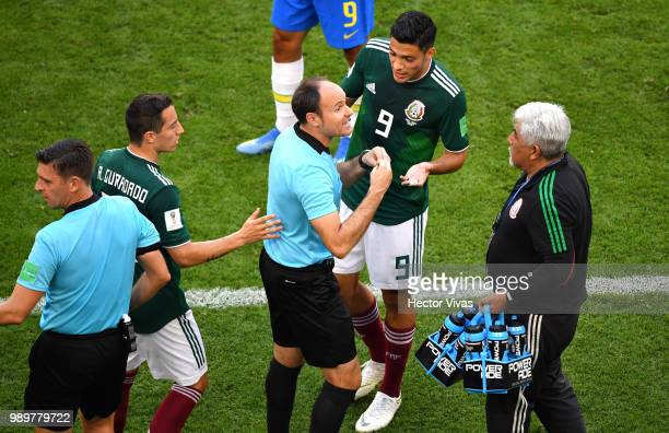 Raul Jimenez of Mexico argues with fourth official Antonio Mateu Lahoz during the 2018 FIFA World Cup Russia Round of 16 match between Brazil and...
