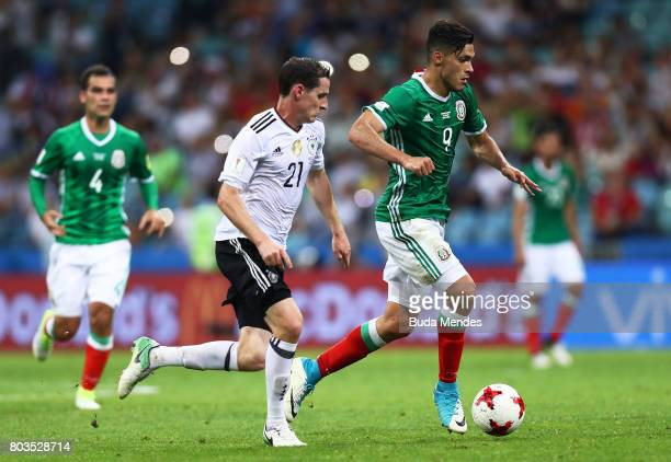 Raul Jimenez of Mexico attempts to take the ball past Sebastian Rudy of Germany during the FIFA Confederations Cup Russia 2017 SemiFinal between...
