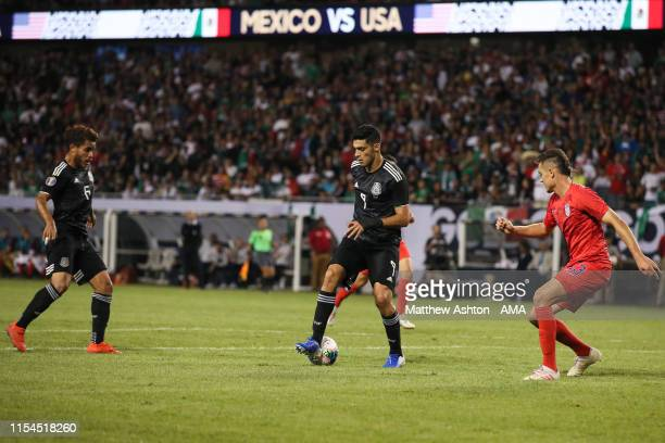 Raul Jimenez of Mexico backheels the ball to Jonathan dos Santos of Mexico setting up his goal during the 2019 CONCACAF Gold Cup Final between Mexico...