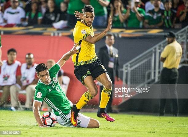Raul Jimenez of Mexico battles Jobi McAnuff of Jamaica during the Copa America Centenario Group C match between Mexico and Jamaica at the Rose Bowl...