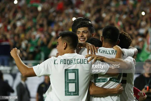 Raul Jimenez of Mexico celebrates 1st goal with his teammates during the 2019 CONCACAF Gold Cup semifinal match between Haiti and Mexico at State...