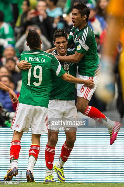 Raul Jimenez of Mexico celebrates after a goal during a match between Mexico and New Zealand as part of the FIFA World Cup Qualifiers at Azteca...