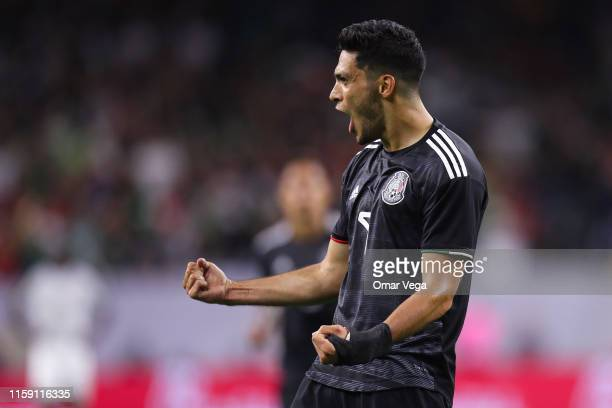 Raul Jimenez of Mexico celebrates after scoring his team's 1st goal during a quarterfinal match between Mexico and Costa Rica as part of 2019...