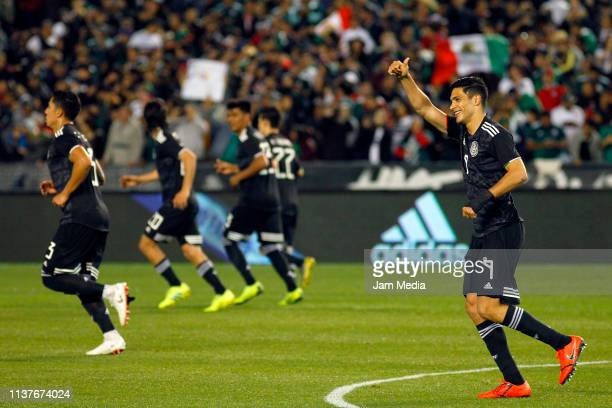 Raul Jimenez of Mexico celebrates after scoring the first goal of his team during an international friendly match between Chile and Mexico at...