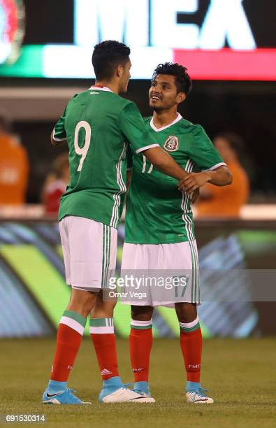 Raul Jimenez of Mexico celebrates his penalty goal with teammate Jesus Corona during the friendly match between the Republic of Ireland and Mexico at...