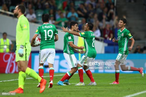 Raul Jimenez of Mexico celebrates scoring his sides first goal with his Mexico team mates during the FIFA Confederations Cup Russia 2017 Group A...