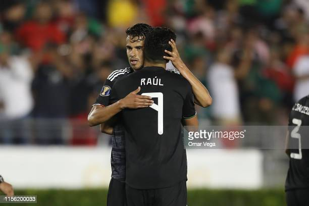 Raul Jimenez of Mexico celebrates with Diego Reyes after scoring his team's fifth goal during a CONCACAF Gold Cup Group A match between Mexico and...