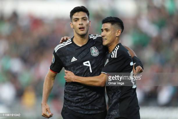 Raul Jimenez of Mexico celebrates with teammate Uriel Antuna of Mexico after scoring the second goal of his team during a CONCACAF Gold Cup Group A...