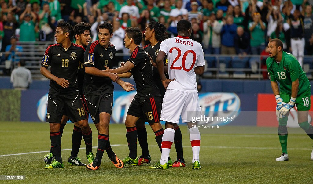 Raul Jimenez #9 of Mexico celebrates with teammates after scoring a goal against Canada at CenturyLink Field on July 11, 2013 in Seattle, Washington.