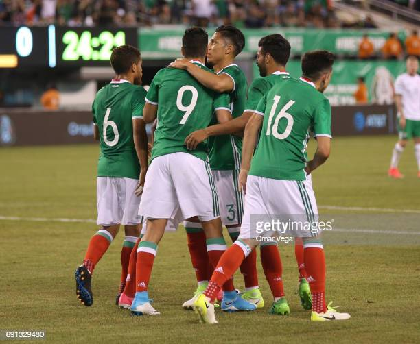 Raul Jimenez of Mexico celebrates with teammates after scoring during the friendly match between the Republic of Ireland and Mexico at MetLife...