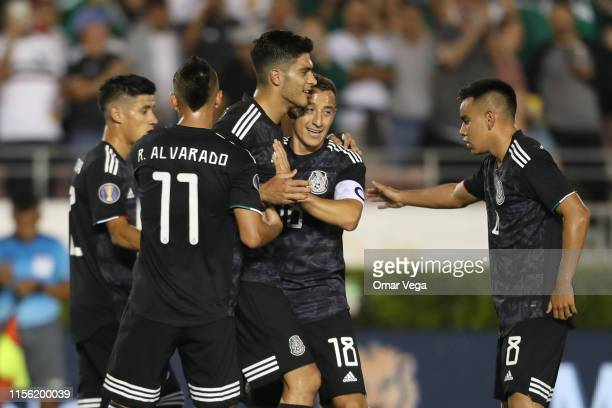 Raul Jimenez of Mexico celebrates with teammates after scoring his team's fifth goal during a CONCACAF Gold Cup Group A match between Mexico and Cuba...