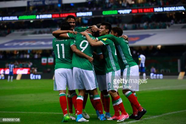 Raul JimŽenez of Mexico celebrates with teammates after scoring his team's third goal during the match between Mexico and Honduras as part of the...