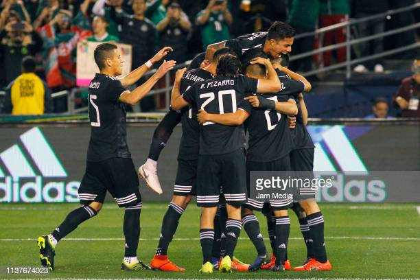 Raul Jimenez of Mexico celebrates with teammates after scoring the first goal of his team during an international friendly match between Chile and...