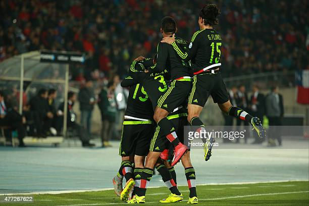 Raul Jimenez of Mexico celebrates with teammates after scoring the second goal of his team during the 2015 Copa America Chile Group A match between...