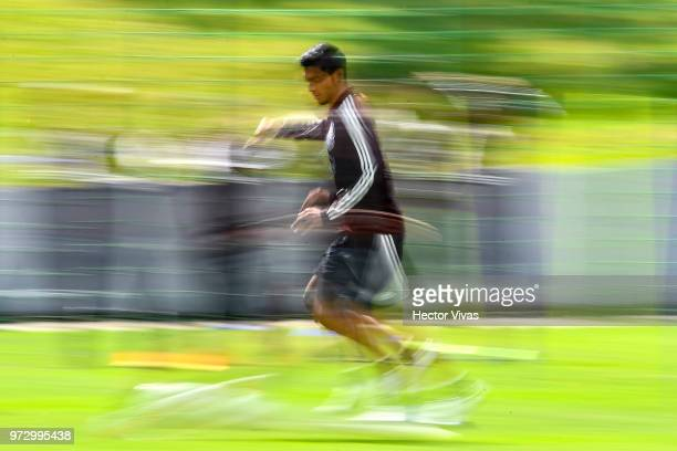Raul Jimenez of Mexico drives the ball during a training session at team training base NovogorskDynamo on June 13 2018 in Moscow Russia