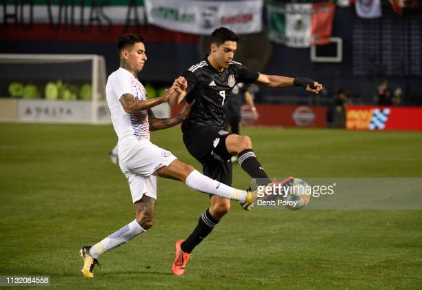 Raul Jimenez of Mexico fights for the ball with Erick Pulgar of Chile during the International Friendly match between Mexico and Chile at SDCCU...