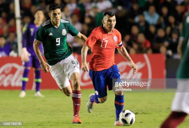 Raul Jimenez of Mexico fights for the ball with Gary Medel of Chile during the international friendly match between Mexico and Chile at La...
