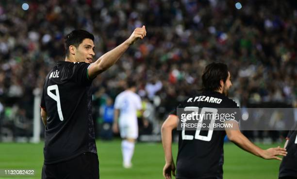 Raul Jimenez of Mexico gestures to the crowd after scoring Mexico's second goal against Chile from the penalty spot during the international friendly...