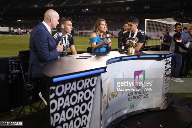 Raul Jimenez of Mexico is interviewed by Lindsay Casinelli of Mexican TV station Univision deportes during the 2019 CONCACAF Gold Cup Final between...