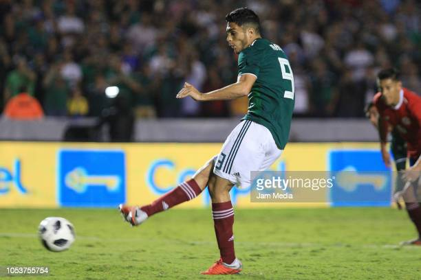 Raul Jimenez of Mexico shoots to score the third goal of his team during the international friendly match between Mexico and Costa Rica at...
