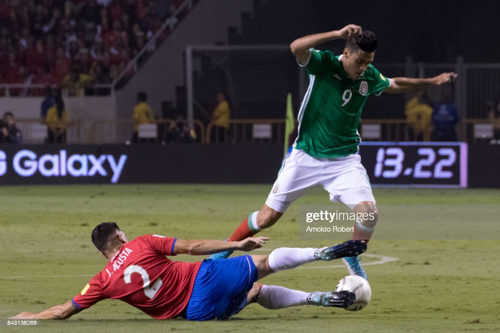 Raul Jimenez of Mexico (R) tries to avoid the slide by Johnny Acosta (L) of Costa Rica during the match between Costa Rica and Mexico as part of the FIFA 2018 World Cup Qualifiers at Nacional de Costa Rica Stadium on September 05, 2017 in San Jose, Costa Rica.