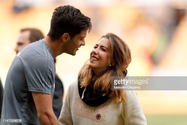Raul Jimenez of Wolverhampton Wanderers and partner Daniela Basso chat following the Premier League match between Wolverhampton Wanderers and Fulham...