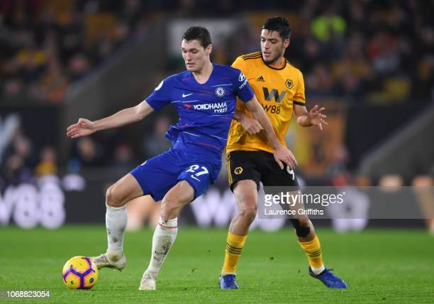 Raul Jimenez of Wolverhampton Wanderers battles for possession with Andreas Christiansen of Chelsea during the Premier League match between...
