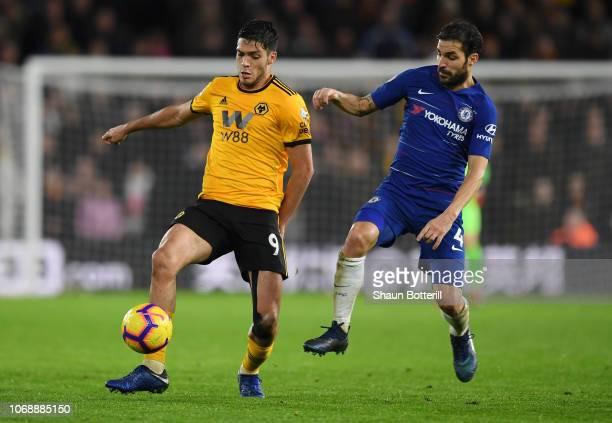Raul Jimenez of Wolverhampton Wanderers battles for possession with Cesc Fabregas of Chelsea during the Premier League match between Wolverhampton...