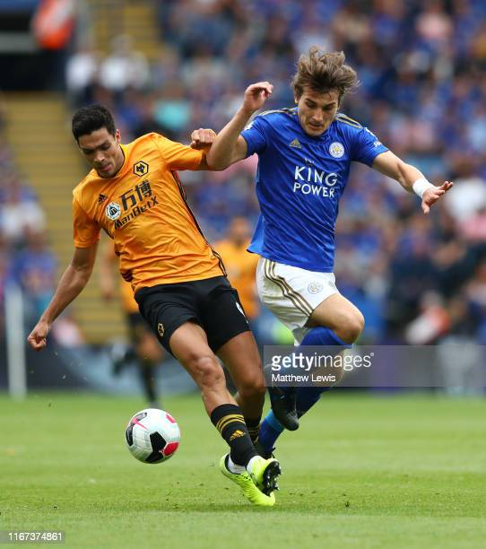 Raul Jimenez of Wolverhampton Wanderers battles for possession with Caglar Soyuncu of Leicester City during the Premier League match between...