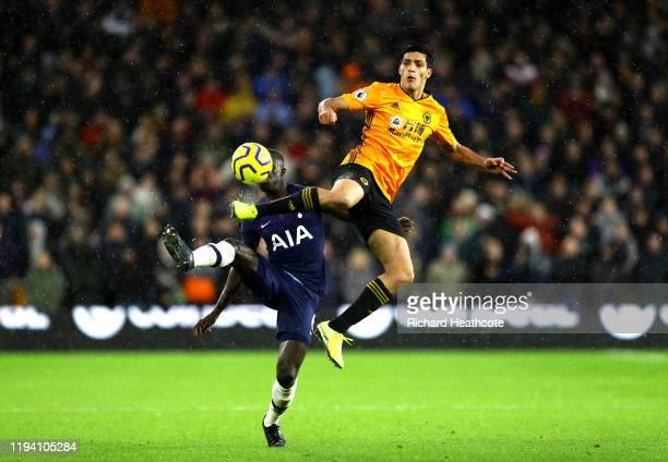 Raul Jimenez of Wolverhampton Wanderers battles for possession with Davinson Sanchez of Tottenham Hotspur during the Premier League match between...